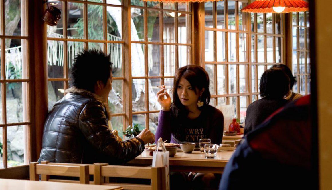woman smoking in restaurant japan